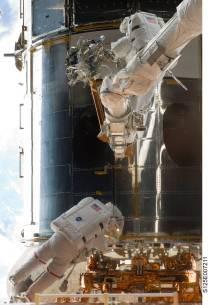 STS 125 Grunsfeld and Feustel spacewalk